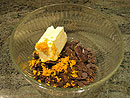 Put the chocolate, butter and orange zest in a heat resistant bowl