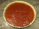 Pour the chocolate mixture into the lined and jam covered crust