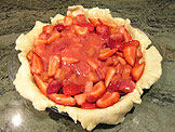 Spoon the fruit evenly into the pie shell and pack lightly.